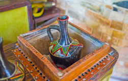 Prepare the Ethiopian coffee. The process of brewing coffee for Ethiopian ceremony, using traditional jebena boiling pot in ethnic cafe Royalty Free Stock Images