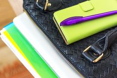 Prepare female bag with laptop, paper documents in folder, phone stock image