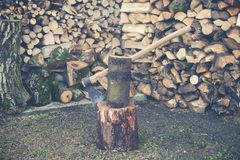 Prepare firewood with axe Royalty Free Stock Photo