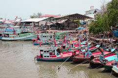 Prepare the fish. Fisherman and boat in sea thai.Fishing boats in Thailand Stock Photos