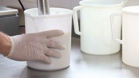 Prepare ice cream with professional machine, chocolate flavor stock video
