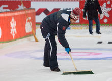 Prepare the ice for curling competition Royalty Free Stock Photo