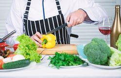 Prepare ingredients for cooking. Useful for significant amount of cooking methods. Basic cooking processes. Man master. Chef or amateur cooking healthy food stock photo