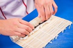Prepare japanese sushi rolls Royalty Free Stock Photos