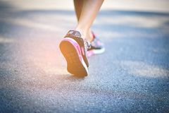 Jogging with sports shoes on holiday For health and beauty. And fat reduction. stock photo