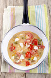 Prepare mediterranean omlette in a pan Royalty Free Stock Photo