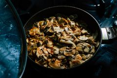 Cooking Mushrooms: Champignons royalty free stock image