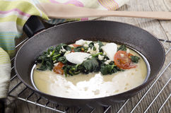 Prepare omelette in a pan Stock Photos