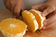 Prepare one orange to make fruitsalad Royalty Free Stock Image