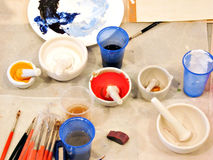 Prepare for painting. Preparation colours for painting. Grinding of natural paints Royalty Free Stock Images