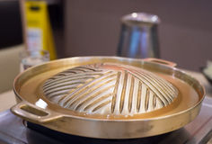Prepare pan brass and soup for grilled. In the mall Royalty Free Stock Photos