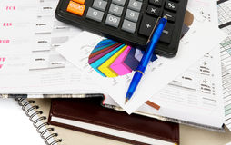 Prepare purchasing and logistics. Arrangement of office supply, calculator, logistics signs and blocks closeup Stock Image