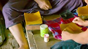 Prepare sheets of paper for gilding. Ancient method Stock Image