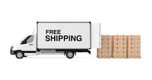 Prepare Shipping Concept. White Commercial Industrial Cargo Deli. Very Van Truck with Free Shipping Sign near Stack of Cardboard Boxes on Pallete on a white Royalty Free Stock Photo