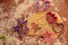 Prepare tasty cookies. family concept. Prepare tasty cookies ,Gingerbread man , heart and star Royalty Free Stock Photography