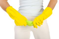 Prepare to clean up. Young woan in yellow rubber gloves wring washcloth. Close up on hands. Front view, white background royalty free stock images