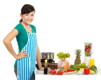 Prepare to cook. Beautiful woman preparing ingredient on the table to cook something Royalty Free Stock Photography