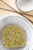 Prepare to cook noodles. Green raw noodles prepare to cook for meal Royalty Free Stock Images