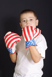 Prepare to fight. Boy in boxing gloves over dark background Stock Photo