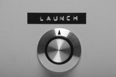 Prepare to Launch. Retro style control switch on a metal panel, pointing at a printed label with the word Launch stock photography