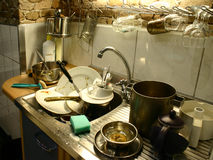 Prepare to wash. Lots of dirty plates, pots and tableware ready to wash Stock Image