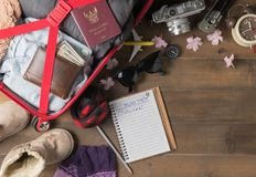 Prepare winter trip and accessories travel items. For on old wooden board, flat lay, top view background Stock Image