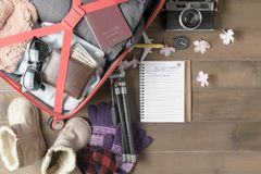 Prepare winter trip and accessories travel items. For on old wooden board, flat lay, top view background Stock Images