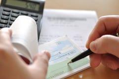 Prepare writing a check Stock Image