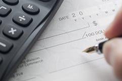 Prepare writing a check Stock Photos