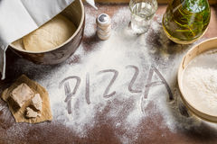 Prepare yeast dough for pizza. On old wooden table Stock Images