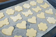 Prepared for baking cookies in the different forms  laid out on a baking sheet Royalty Free Stock Photography