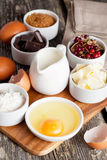 Prepared baking ingredients on wooden table. Vertical, close up Stock Image