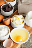 Prepared baking ingredients on wooden table. Vertical, close up Stock Photos