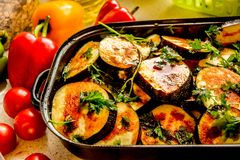 Baking pan with sliced and spiced aubergines. stock photography