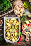 Prepared baking potatoes with garlic and rosemary Royalty Free Stock Images