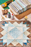 Prepared blocks for sewing quilt, stack of fabrics, sew accessories Royalty Free Stock Images