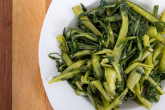 Prepared boiled dandelion greens bowl Stock Photo