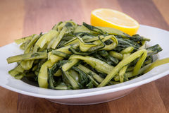 Prepared boiled dandelion greens bowl Royalty Free Stock Photography