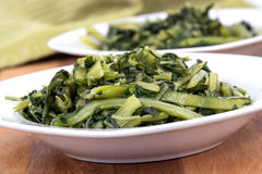 Prepared boiled dandelion greens bowl Royalty Free Stock Images