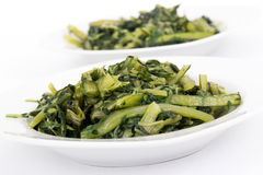 Prepared boiled dandelion greens bowl Stock Photos