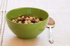 Prepared breakfast with cereals in a green bowl Royalty Free Stock Image
