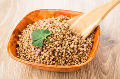 Prepared buckwheat in bamboo bowl with wooden spoon Stock Photos