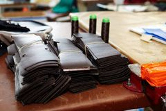 Prepared, bundled leather parts, used in the production of shoes, handbags. Belts stock image