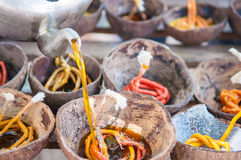Prepared candle and old coconut shell for Loy kratong festival i Stock Image