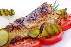 Prepared carp on a plate. Royalty Free Stock Photos