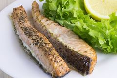 Prepared, cooked, fried, baked salmon fish steaks. stock image