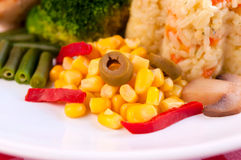 Prepared corn. With olive. Selective focus on the corn stock photo