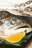 Prepared and delicious sushi fish head. Prepared and delicious sushi fish steak with lemons Stock Photography