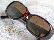 Prepared for driving. A pair of driving glasses on a road map Stock Photos