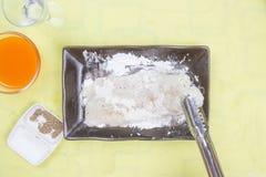 Prepared fillet of  Dory fish mixed flour Stock Photos
